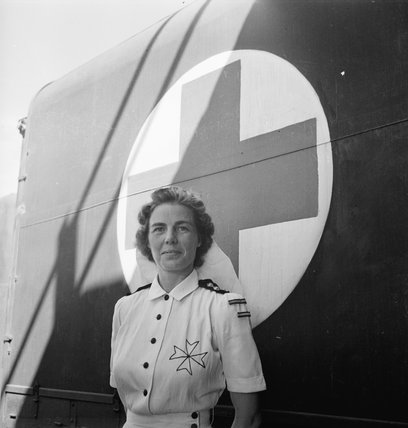 A St John's Ambulance Nurse, Mrs Ker, waits to assist casualties arriving from Burma at Dum Dum airfield in Calcutta, India, 1944