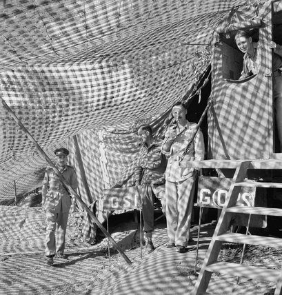 14TH ARMY ON THE ARAKAN FRONT:  4 LIAISON OFFICERS UNDER A CAMOUFLAGE NETTING DRAPED LORRY WHICH SERVED AS 5th DIV HQ MOBILE OFFICE