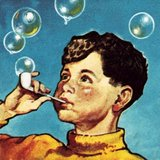 Boy blowing bubbles from a pipe
