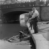 Police diver in canal; c.1955