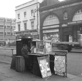 Newspaper vendor on the Edgware Road. c.1955