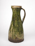 Tall jug with a green glaze: early 14th century
