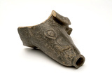 Fragment of a Roman bowl in the shape of a boar's head