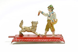 Mechanical penny toy figure of boy and dog: 1905