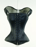 Black cotton long line corset: 19th century