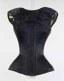 Long line corset of black cotton, back view: 19th century