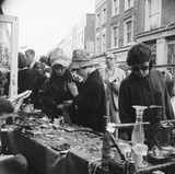 A stall at Portobello Road Market, Notting Hill: 20th century