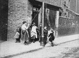 Children dance around a maypole: 1893