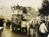 Procession of cart advertising 'Votes for Women.': 1909