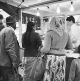 Customers at a market stall on the Portobello Road:1960