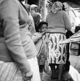 Young boy in a market crowd, Portobello Road: 1960
