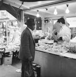 Customer at a market stall, Portabello Road: 1960