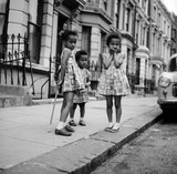 Three young girls, Notting Hill: 1960