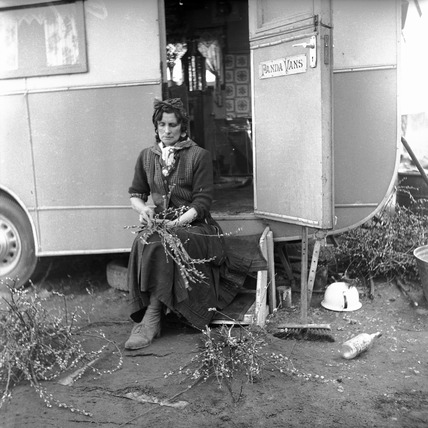 A gypsy woman making posies: c.1960