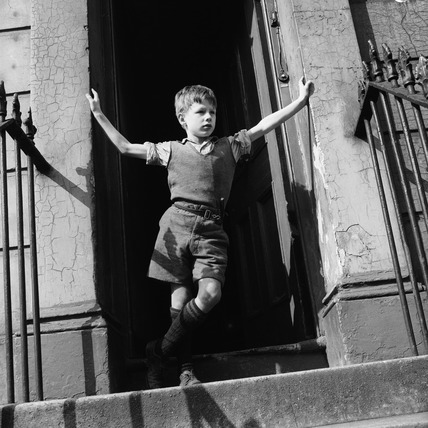 A boy on the steps of a house in Ladbroke Grove:1957