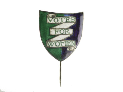 Shield-shaped silver and enamel pin or lapel badge: c. 1908