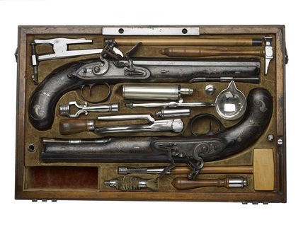 Flintlock duelling pistols in a box: c.1810