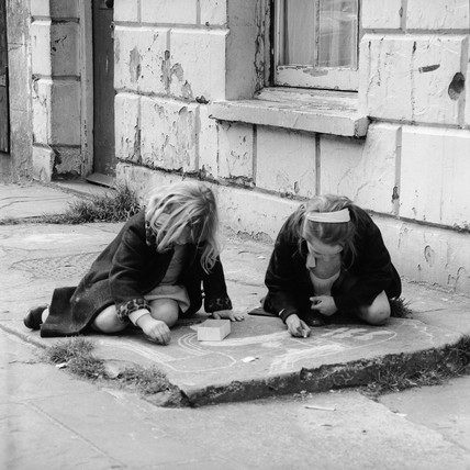 Girls drawing in chalk on the pavement: c.1965