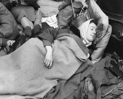 A woman camps out on the street for Queen Elizabeth's Coronation: 1953