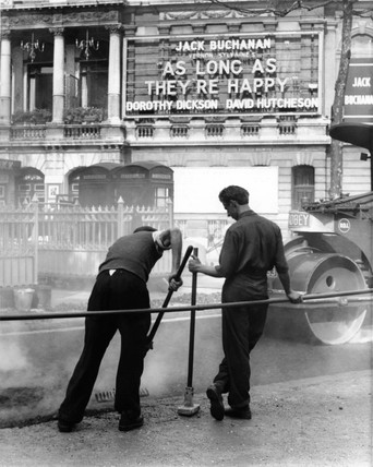 Road workers outside the Garrick Theatre on Charing Cross Road: 1953