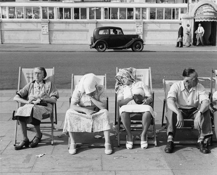 Four pensioners on deckchairs along the Brighton Promenade: c.1950