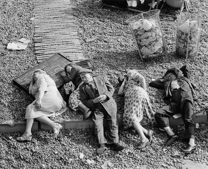 Five pensioners lying on the pebbles of Brighton Beach: c. 1955