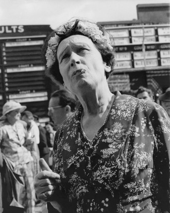 A woman at Derby Day races, Epsom Downs: c. 1960