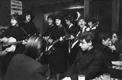 Members of the Salvation Army playing in a coffee bar c. 1960