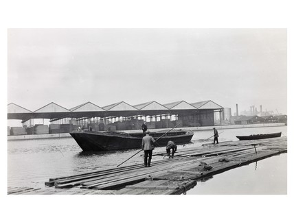 Working a timber raft at Surrey Commercial Docks: c. 1925