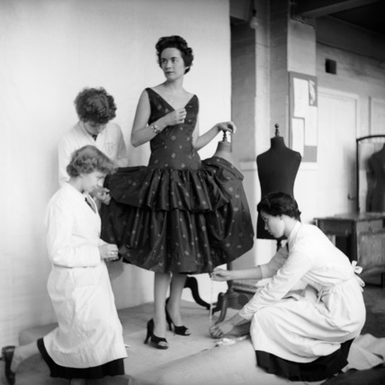 Students fitting a dress; 1955