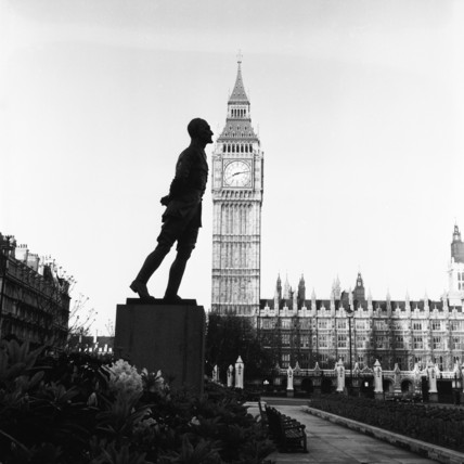 Statue of Jan Christian Smuts silhouetted against Big Ben clock tower; c. 1953