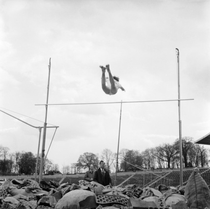 Athlete pole jumping; c. 1967