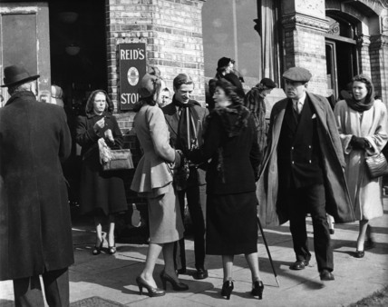 Men and women outside a Hammersmith pub on boat race day, c.1952