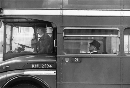 A Routemaster bus stuck in traffic on London Bridge during rush hour; 1978