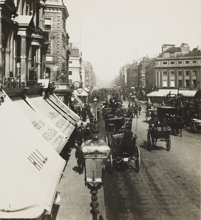 Busy street scene at Oxford Circus; c.1900