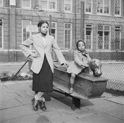 East London Afro-Caribbean child and mother in playground; 1952