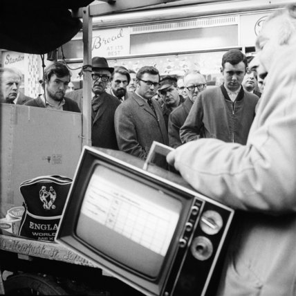 Market trader selling a television; 1955- 1970