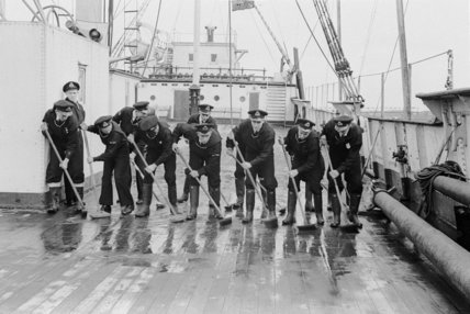 School boys from the H.M.S. Worcester Merchant Navy School scrubbing the deck of the Cutty Sark