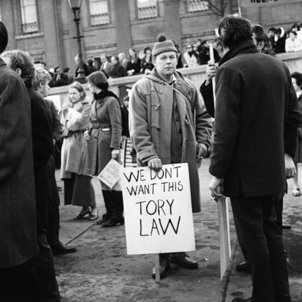 Man holding a sign reading 'We Don't Want This Tory Law'; 1971-1972