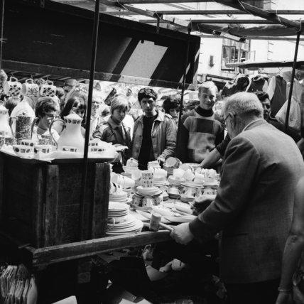 A stall selling crockery at Petticoat Lane Market; c 1965