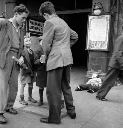 Boys collecting money in a tin for Guy Fawkes; c. 1955