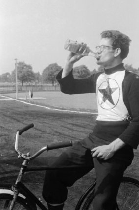 Young speedway cyclist racing his bike; 1954-1955