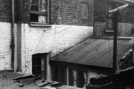 The roof of a condemned house in Cable Street; 1951