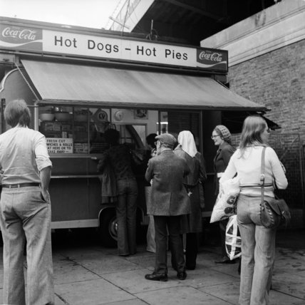 Hot dog vendor selling pies; c.1965