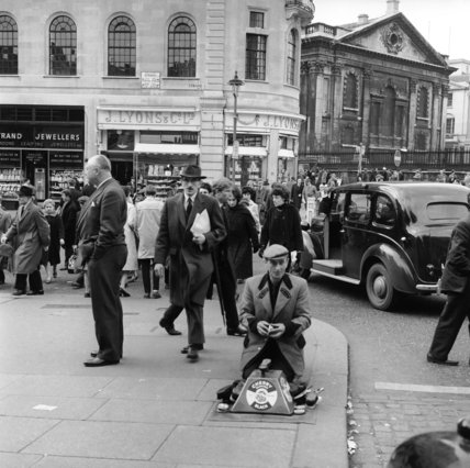 A 'shoeblack' by the Strand; 1963