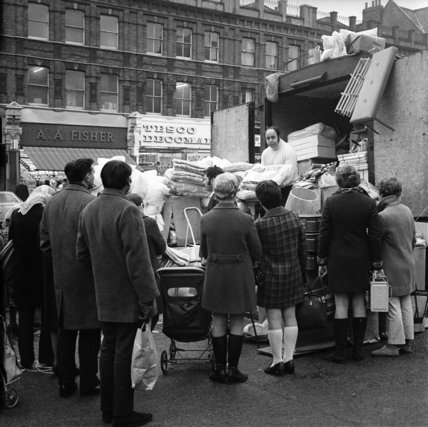 Trader selling from the back of a van in Cricklewood; c.1965