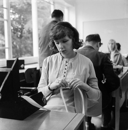 A girl reads back her braille shorthand; 1965