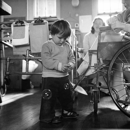 Young boy blows bubbles at Whittington Children's Hospital; 1965