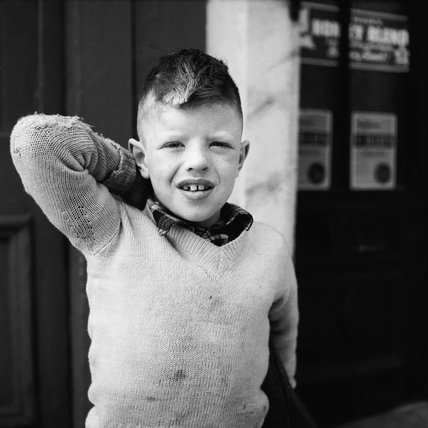 Portrait of a young boy in an Islington street; 1956