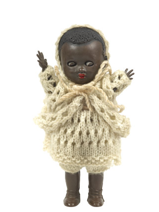 Small black plastic doll; c. 1950